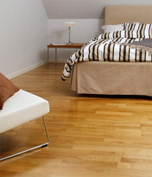 bona mega water base finish for wood floors in a red oak bedroom